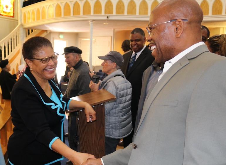 Rep. Karen Bass (D-CA-37) greeting and shaking hands.